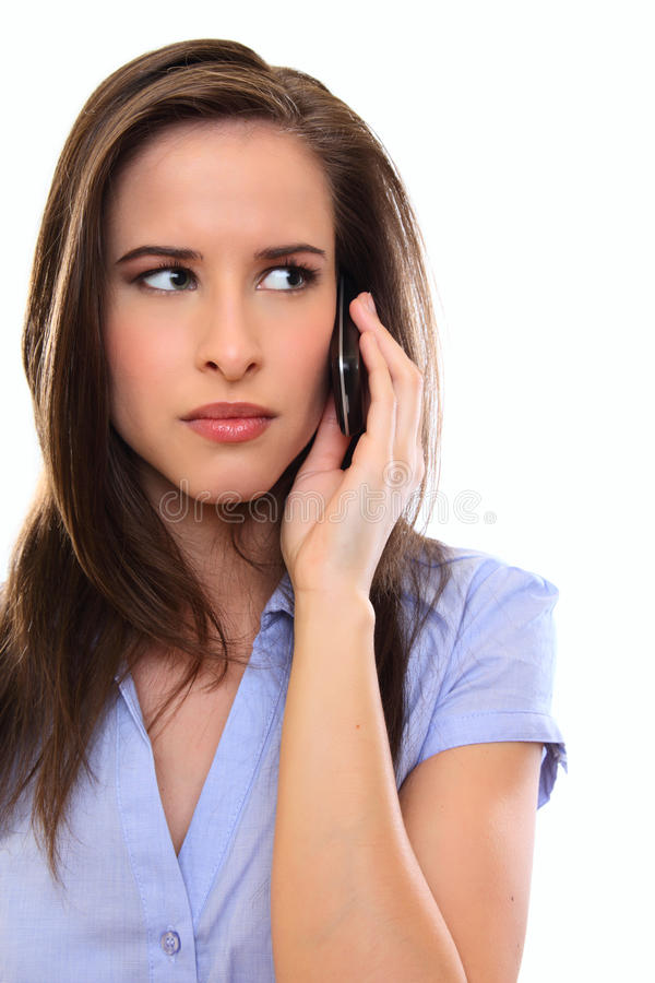 Nervöse Brunettefrau, die einen Aufruf bildet stockbilder