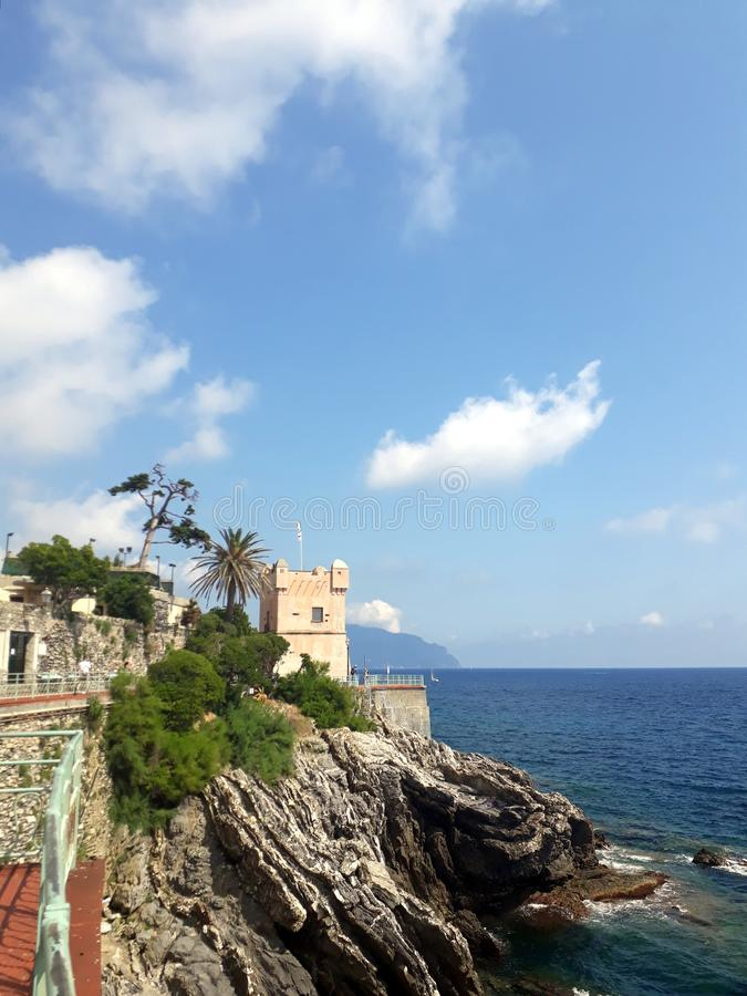 Nervi promenade. Nervi, Genoa, Italy. Landscape with various vegetation, sea and rocks under a blue sky. A touristic promenade in contact with nature stock image