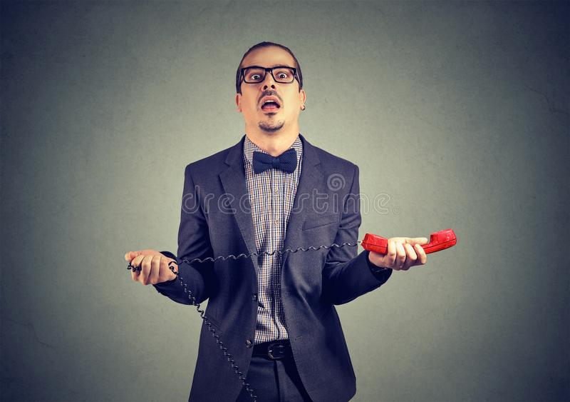 Nervous annoyed businessman with telephone royalty free stock photos
