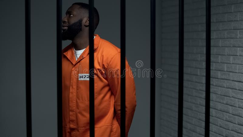Nervous black prisoner waiting sentence in solitary cell, convicted criminal royalty free stock images