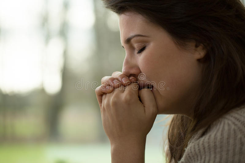 Nervous breakdown. Young woman with a nervous breakdown stock image