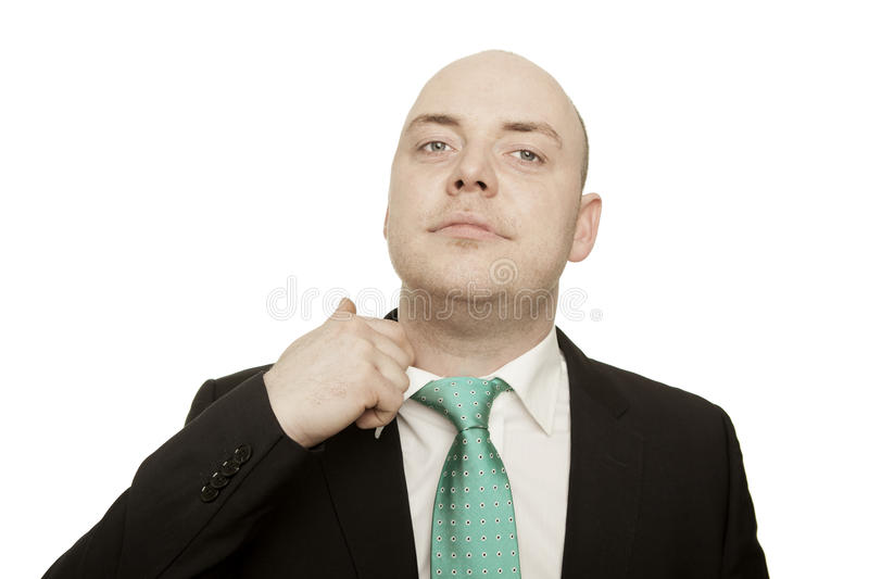 Nervous businessman loosening his tie stock photos