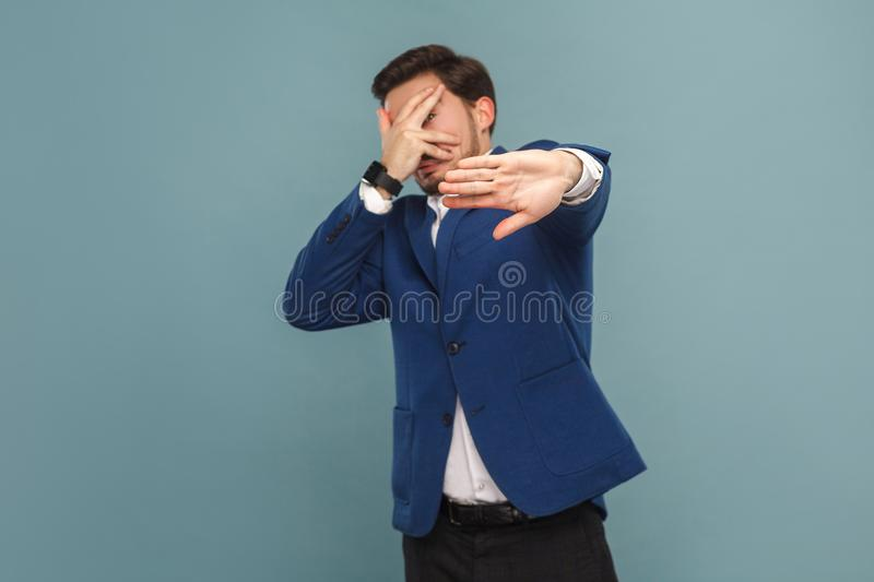 Nervous businessman scared and panic stock photography