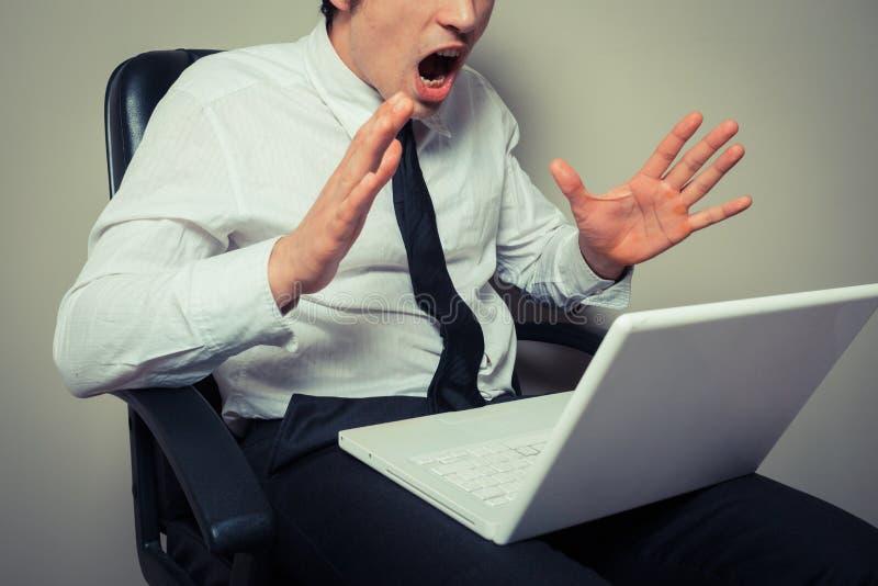 Nervous businessman wih laptop royalty free stock photos