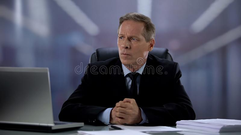 Nervous businessman worrying about important contract, stressed lifestyle royalty free stock images