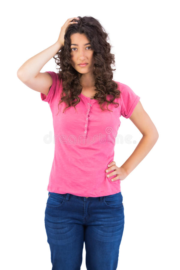 Nervous cute brunette posing royalty free stock images