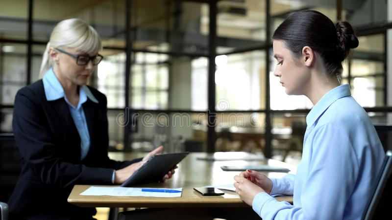 Nervous employee and strict boss in office, stressful atmosphere at work. Stock photo royalty free stock image