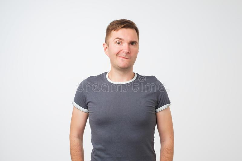 Nervous european doubtful male biting lips having puzzled look going to make serious decision royalty free stock photos