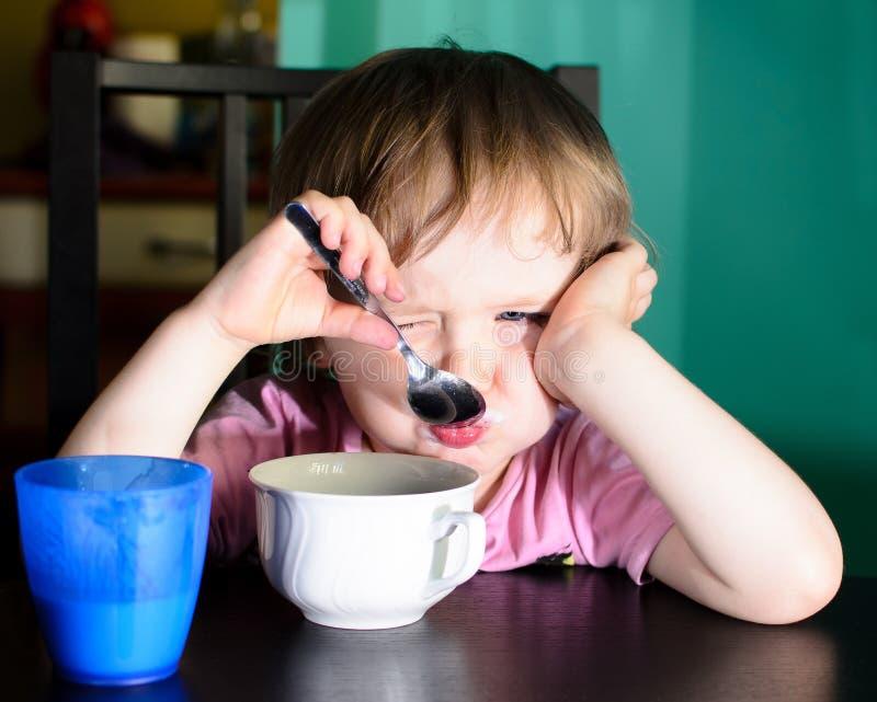Nervous little boy eating