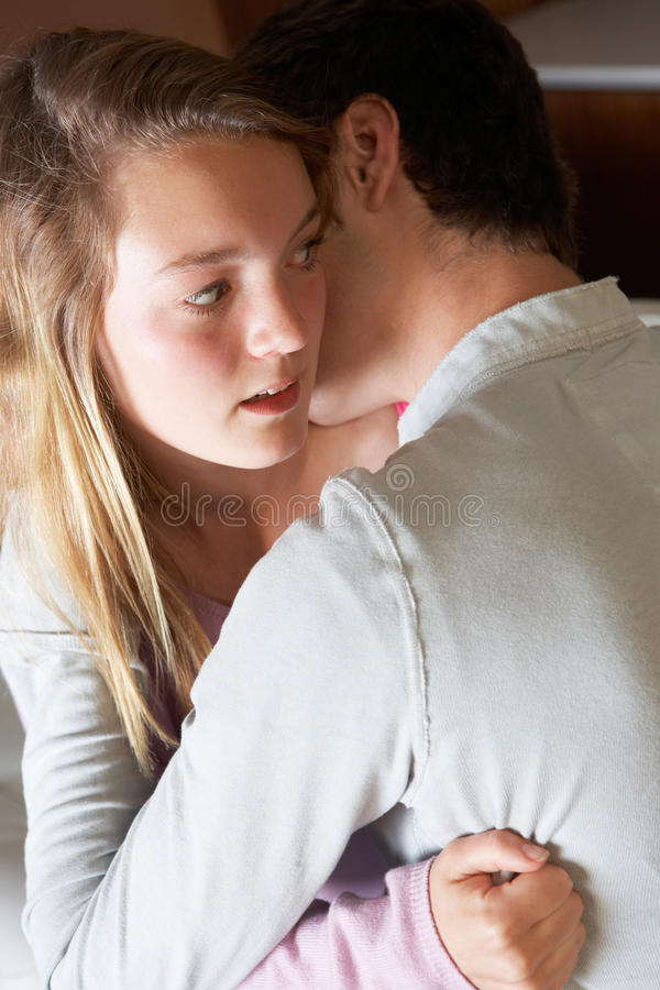 Download Nervous Looking Teenage Girl Sitting On Sofa Royalty Free Stock Photos - Image: 18031698