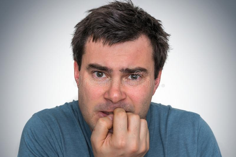Nervous man biting his nails - nervous breakdown stock photos
