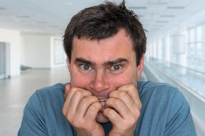 Nervous man biting his nails - nervous breakdown stock images