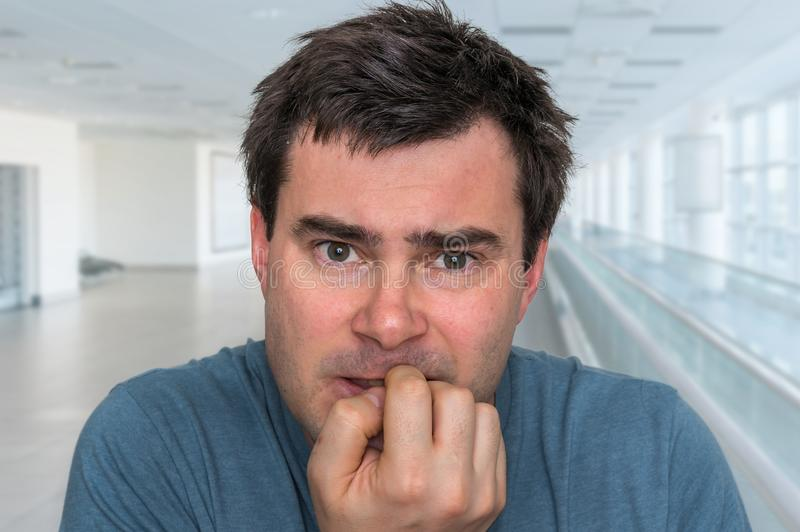 Nervous man biting his nails - nervous breakdown stock photos