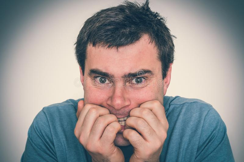Nervous man biting his nails - nervous breakdown royalty free stock images