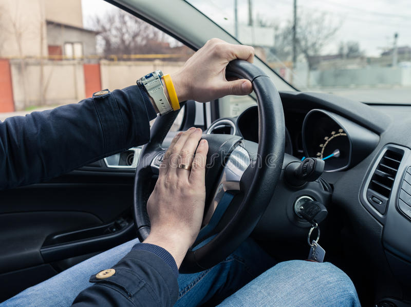 Nervous man driver pushing car horn royalty free stock images