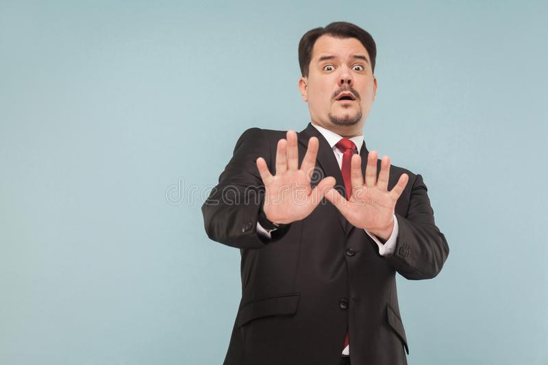 Nervous man scared and looking at camera with fear in eyes stock photos