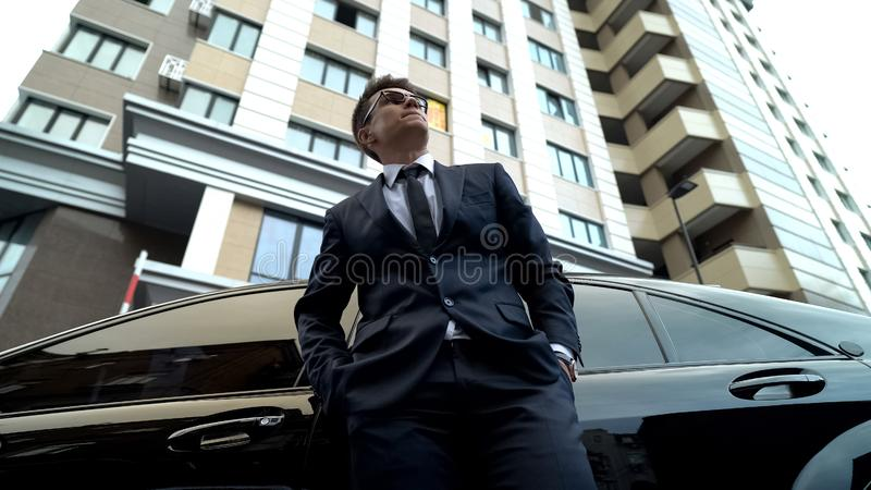 Nervous politician standing by car, life difficulties, problems at work, crisis. Stock photo royalty free stock image