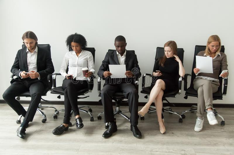 Nervous stressed job applicants preparing for interview waiting stock photos