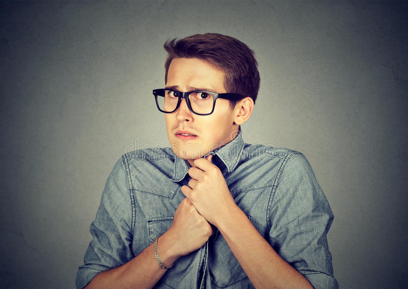 Nervous stressed man feels awkward looking anxiously craving something. Nervous stressed young man student feels awkward looking at camera anxiously craving royalty free stock photos