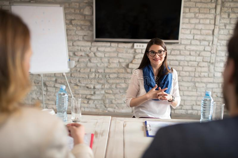 Nervous woman on interview for job royalty free stock image