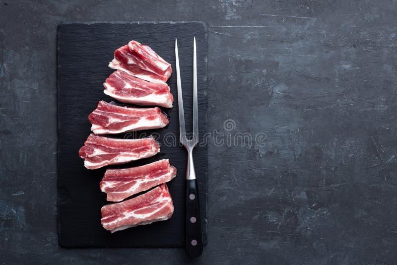 Nervures de porc crues photos stock