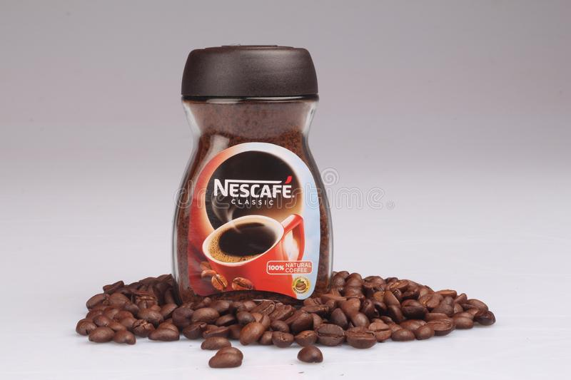 Nescafe Classic Coffee Powder and beans royalty free stock images