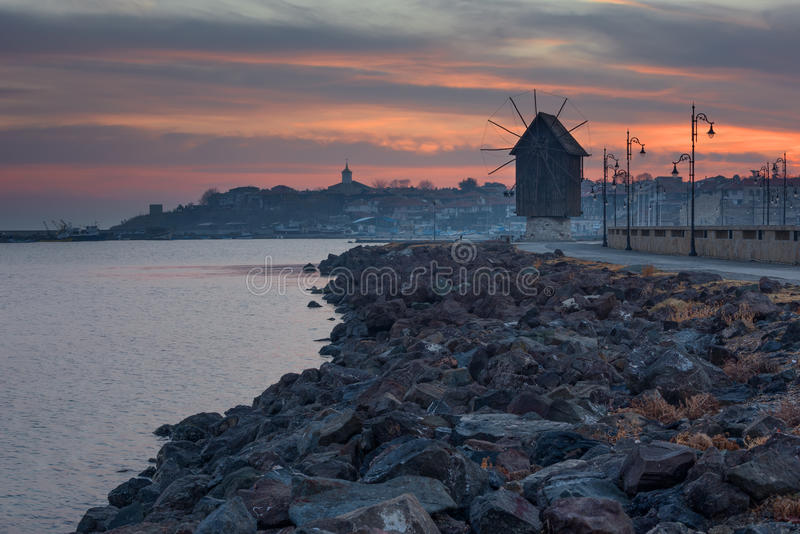 NESEBAR, BULGARIA - February 05, 2017: Old windmill in the ancient town of Nesebar, Bulgaria.Bulgarian Black Sea coast. stock photos