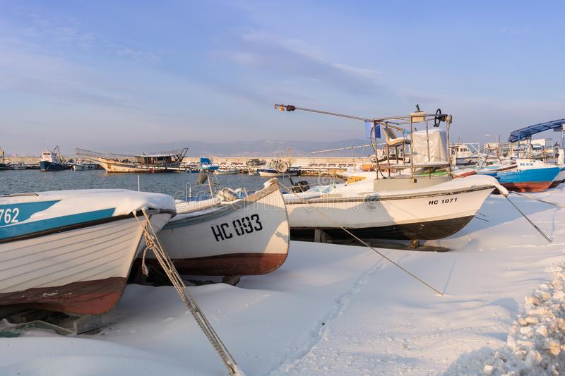 Nesebar, Bulgaria - January 12, 2017: Ships and boats covered in snow in the port of the old town Nessebar on the bulgarian Black royalty free stock photography