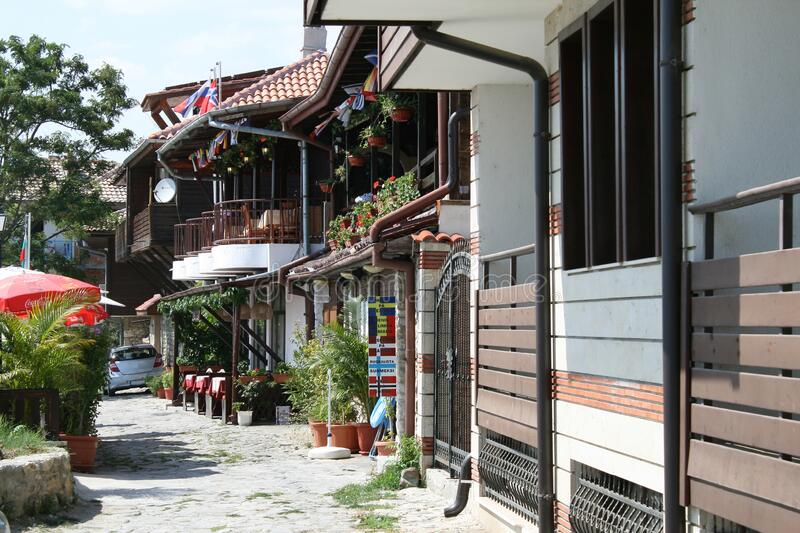 Old Town of Nesebar, a cozy street with restaurants. Very popular place with tourists who come to Bulgaria stock photography