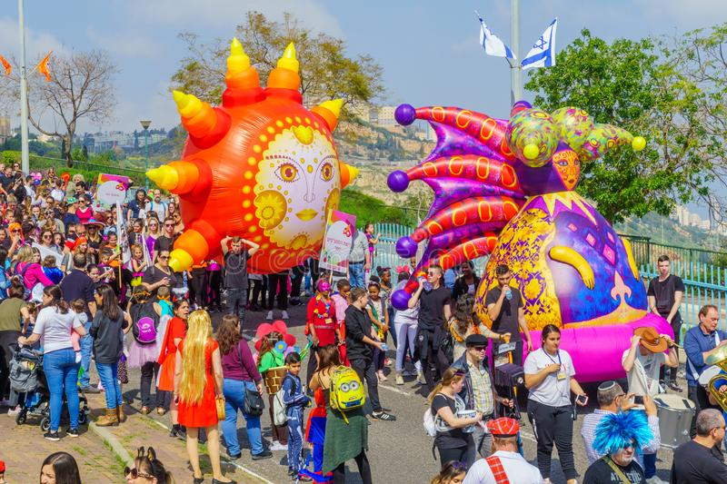 Purim Adloyada parade, in Nesher. Nesher, Israel - March 22, 2019: People, some in costumes, celebrate the Jewish holyday of Purim in the Adloyada parade, in royalty free stock photography