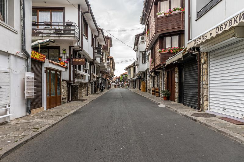 Beautiful and narrow street with restaurants, cafes and shops of the ancient seaside town. Deserted streets in the early morning royalty free stock image