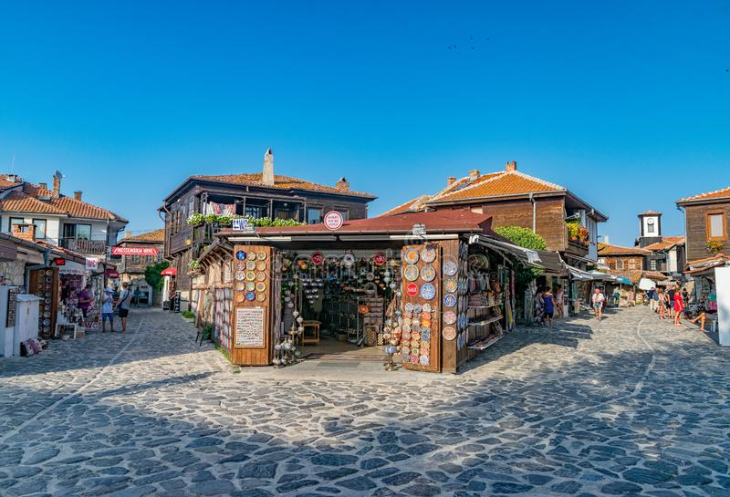 Nessebar, Bulgaria - 2 Sep 2018: Beautiful old wooden houses on the streets of Nesebar ancient city on a sunny day with blue sky. stock image