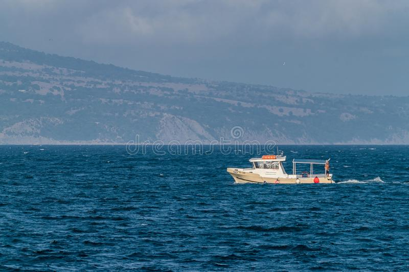 Nessebar, Bulgaria - 2 Sep 2018: A boat transporting tourists between Sunny Beach and Nesebar ancient city, one of the major royalty free stock image