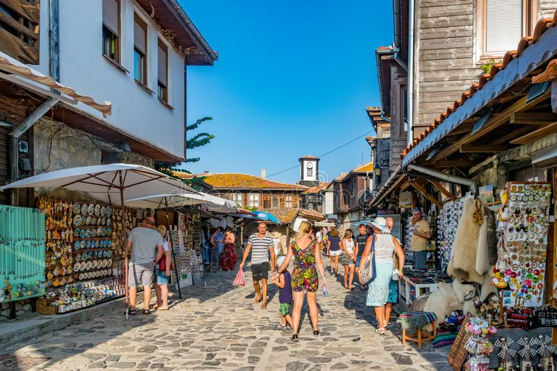 Nessebar, Bulgaria - 2 Sep 2018: Tourists on the beautiful streets of Nesebar ancient city on a sunny day with blue sky. Nessebar stock images