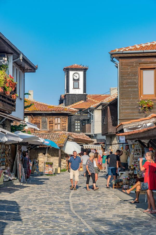 Nessebar, Bulgaria - 2 Sep 2018: Tourists on the beautiful streets of Nesebar ancient city on a sunny day with blue sky. Nessebar royalty free stock photo