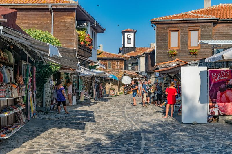 Nessebar, Bulgaria - 2 Sep 2018: Tourists on the beautiful streets of Nesebar ancient city on a sunny day with blue sky. Nessebar royalty free stock photography