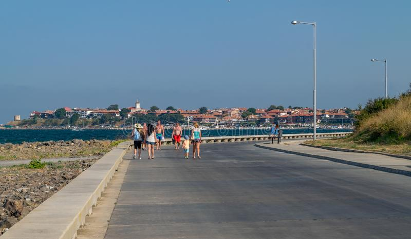 Nessebar, Bulgaria - 2 Sep 2018: Tourists walking to the Nesebar ancient city, one of the major seaside resorts on the Bulgarian stock images