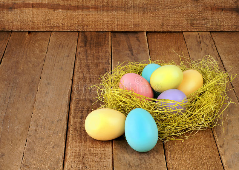 Nest of Easter Eggs on Rustic Wood royalty free stock image