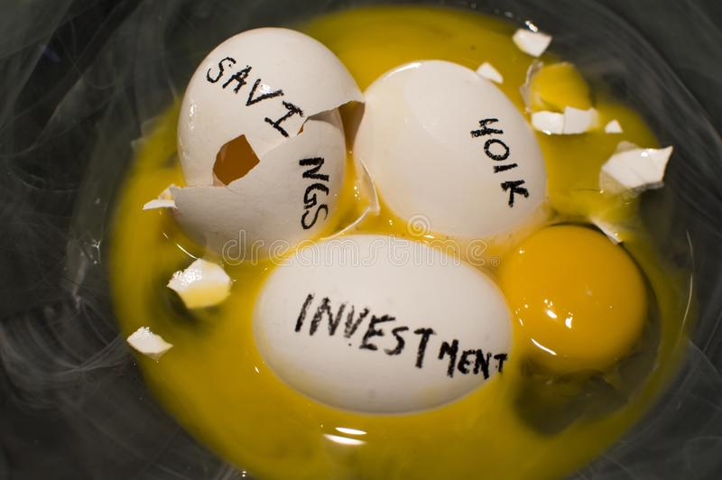 Nest egg. The concept of nest eggs putting all your eggs in one basket symbolism broken eggs and lost savings how to get on track and protect investments royalty free stock photo