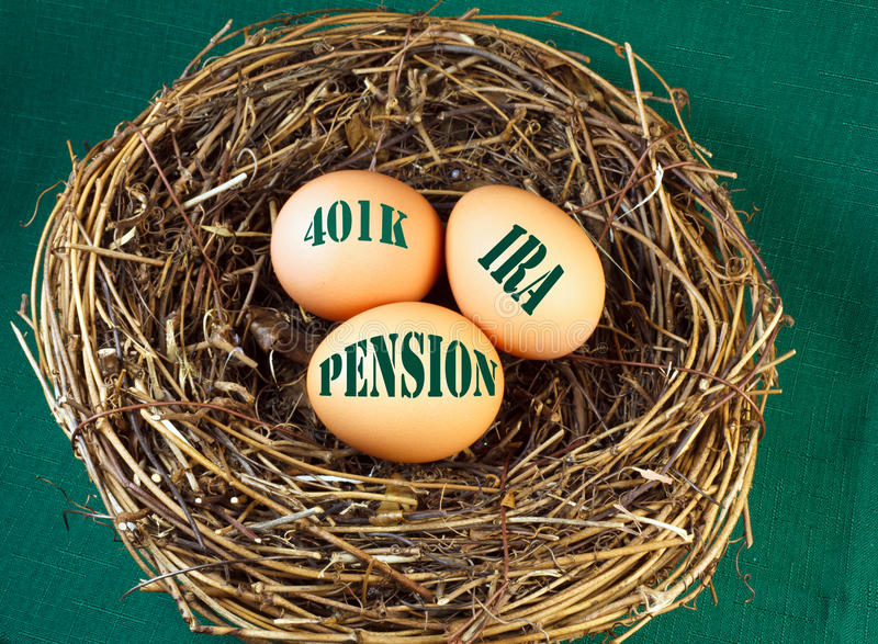 Nest egg for retirement. Nest with eggs and the words 401k, IRA, and Penstion for retirement or future financial stability stock photography