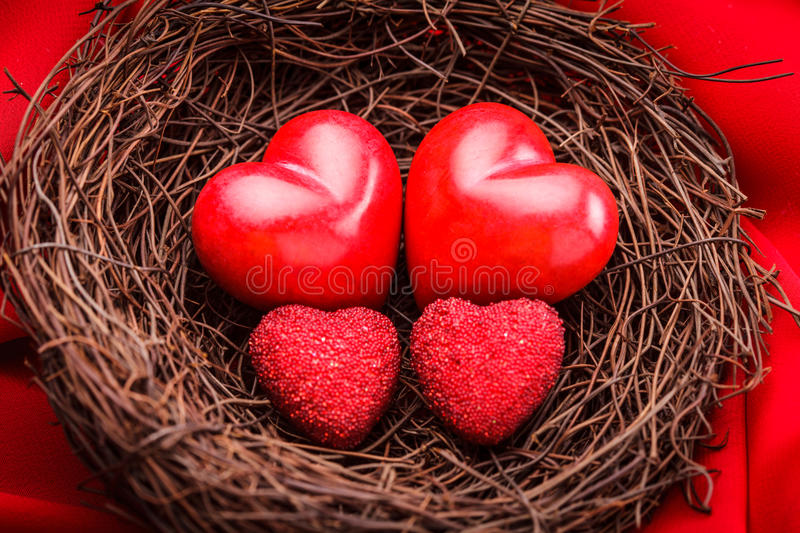 Nest with hearts stock photos