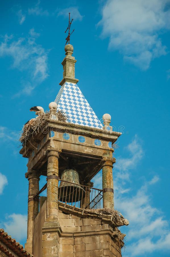 Nest of storks on top of stone bellow tower at Trujillo stock images
