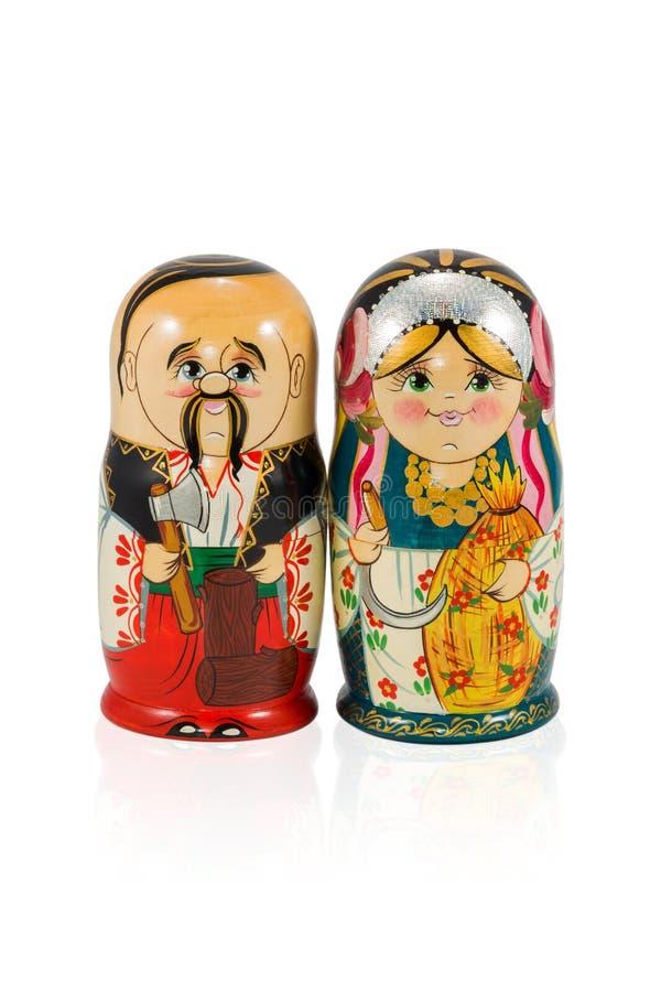Nested dolls couple husband and wife. Ukrainian nested doll couple isolated on white background stock photography