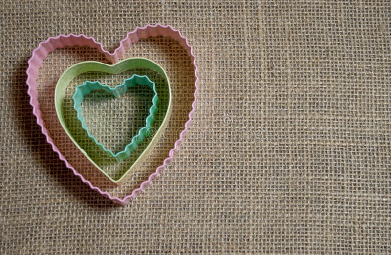 Download Nested Pastel Hearts On Burlap Stock Photo - Image: 83723962