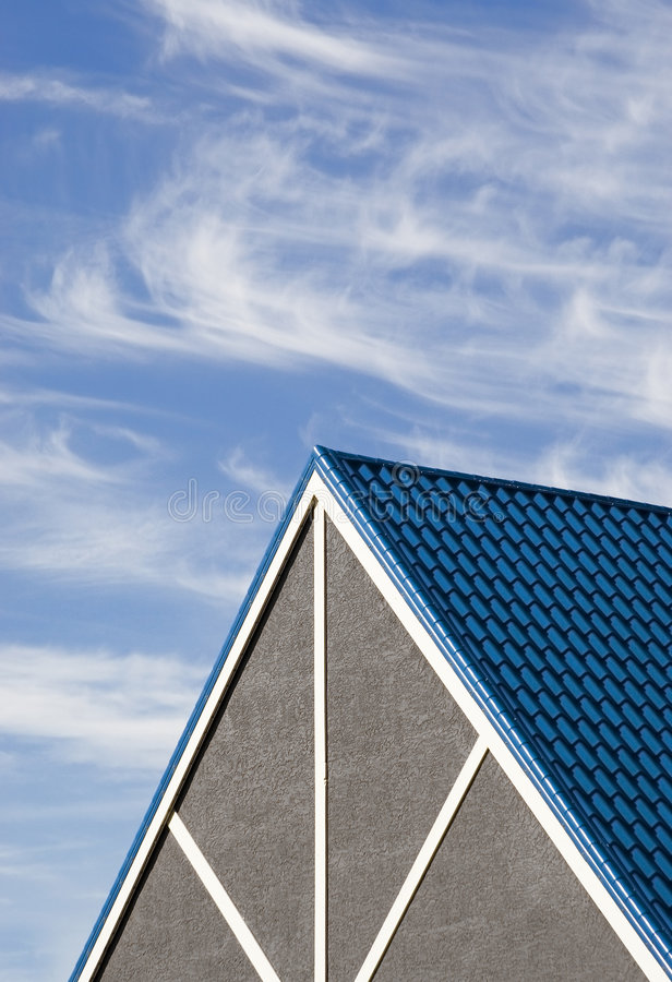 Nester's Peak. Steeply pitched roof peak against sky and clouds stock photography