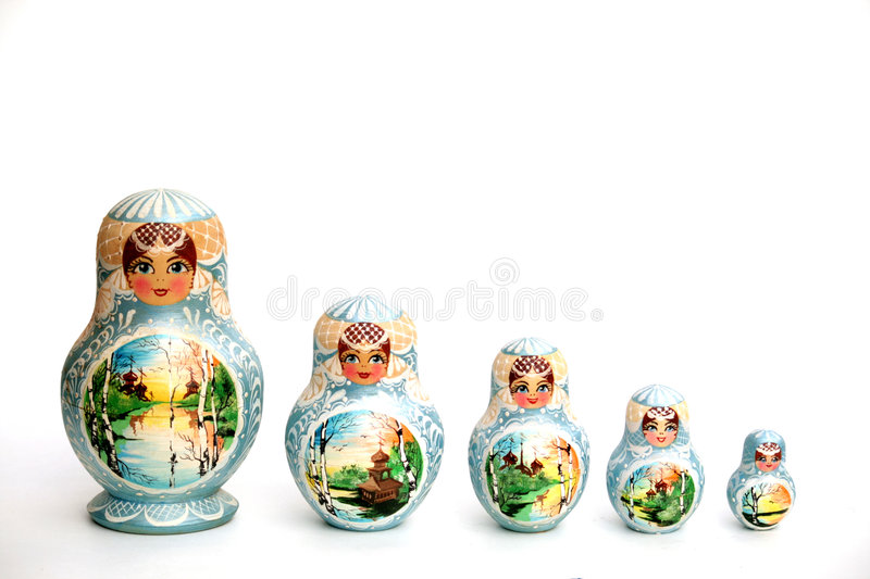 Nesting Dolls. Five nesting dolls matreshka as souvenirs stock photos