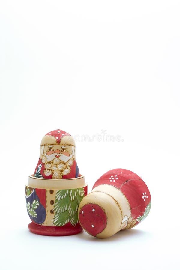 Nesting Santa dolls. Santa Claus nesting dolls on white background royalty free stock images