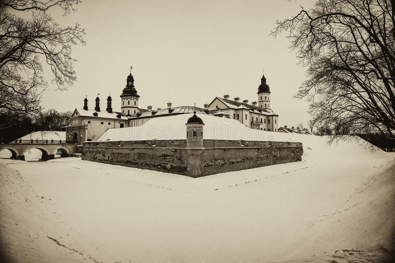Nesvizh Castle. winter. Belarusian attraction Nesvizh castle covered with snow in the winter season. retro style stock photography