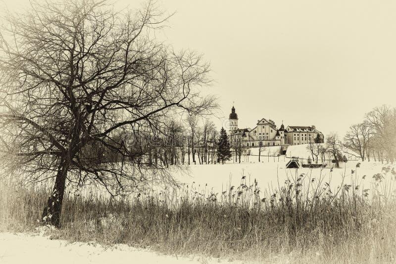 Nesvizh Castle. winter. Belarusian attraction Nesvizh castle covered with snow in the winter season. retro style royalty free stock photos