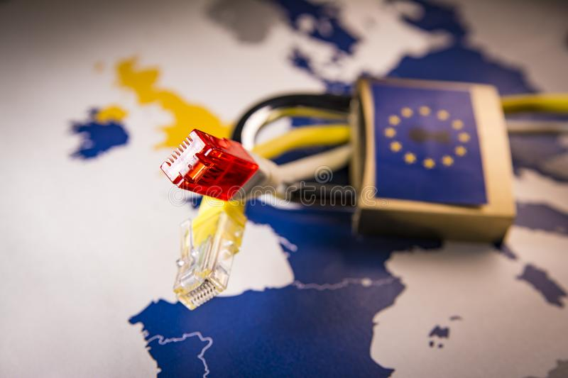 Net cable with Padlock over EU map on the background, GDPR metaphor. Net cable with Padlock over EU map on the background, symbolizing the EU General Data stock photography